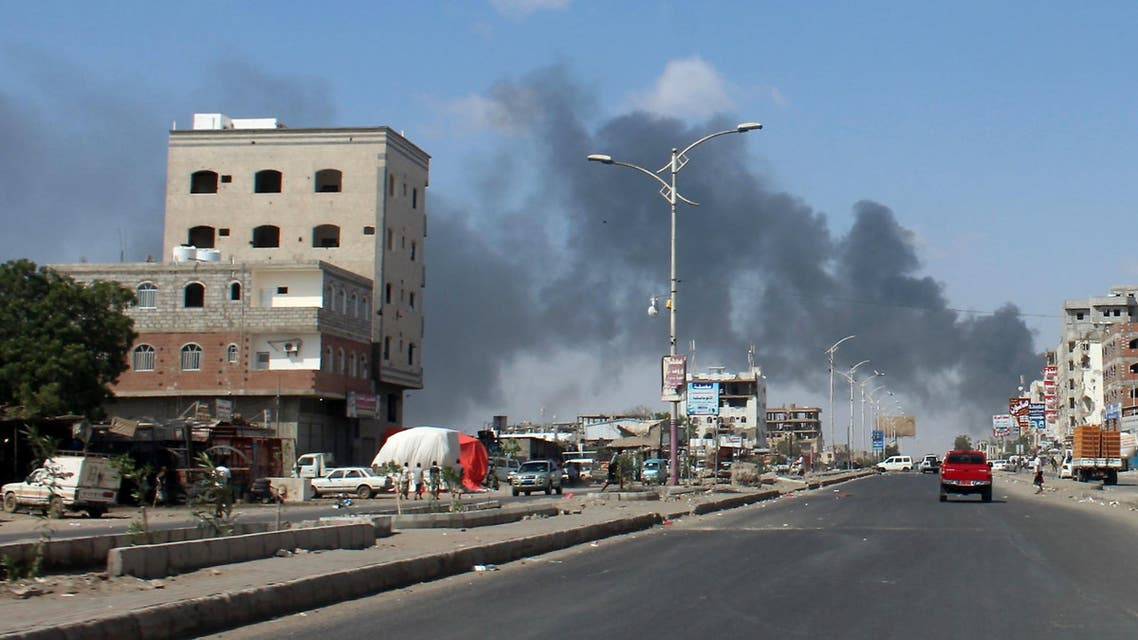 Smoke billows in the government's de facto capital Aden, as fighters from the separatist Southern Transitional Council move closer to taking full control of the southern city, on January 30, 2018. The government has accused the separatists of attempting a coup in Aden, where more than 36 people have been killed in clashes that opened yet another front in the country's devastating conflict. SALEH AL-OBEIDI / AFP
