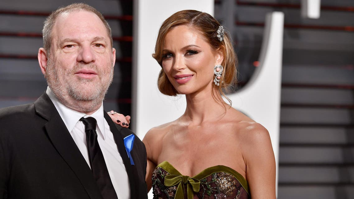 (FILES) In this file photo taken on February 26, 2017 shows Co-Chairman, The Weinstein Company Harvey Weinstein (L) and fashion designer Georgina Chapman attending the 2017 Vanity Fair Oscar Party hosted by Graydon Carter at Wallis Annenberg Center for the Performing Arts in Beverly Hills, California. Marchesa, the fashion label co-owned by Harvey Weinstein's estranged wife Georgina Chapman and famous for clothing Hollywood starlets, has cancelled its runway show at New York Fashion Week, just months after his downfall for alleged rape and sexual assault.Marchesa has been a fixture of New York's biannual fashion week since September 2006 and had been scheduled to show on February 14 -- Valentine's Day, rather awkwardly.  PASCAL LE SEGRETAIN / GETTY IMAGES NORTH AMERICA / AFP