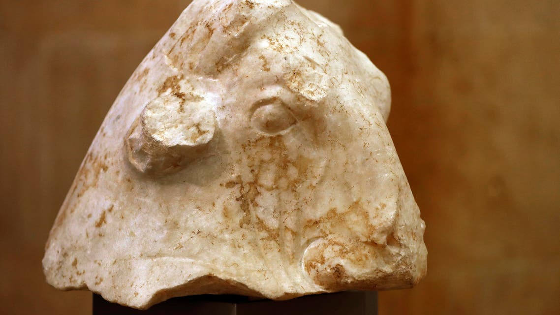 """The ancient sculpture """"Bull's Head"""" is displayed at the Lebanese National museum during a ceremony celebrating the return of three ancient sculptures from the United States, in Beirut, Lebanon, Friday, Feb. 2, 2018. The treasures once owned by private collectors and valued at more than $5 million US were ordered returned to Lebanon by the Manhattan district attorney. They were stolen from a temple during the Lebanese 1975-90 civil war and confiscated in New York in the past few months. (AP Photo/Hussein Malla)"""