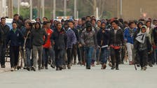 Four migrants critical after being shot in brawl at French port of Calais