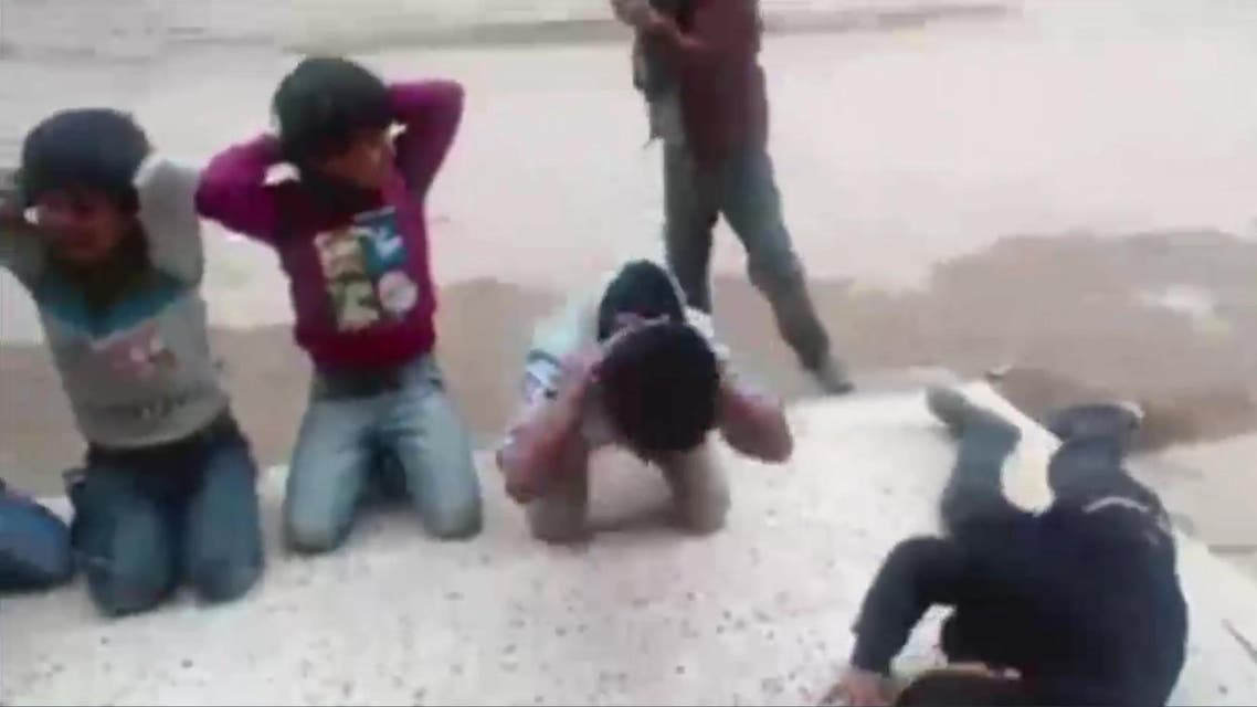 Screen grab - children mimic group excecutions in Libya