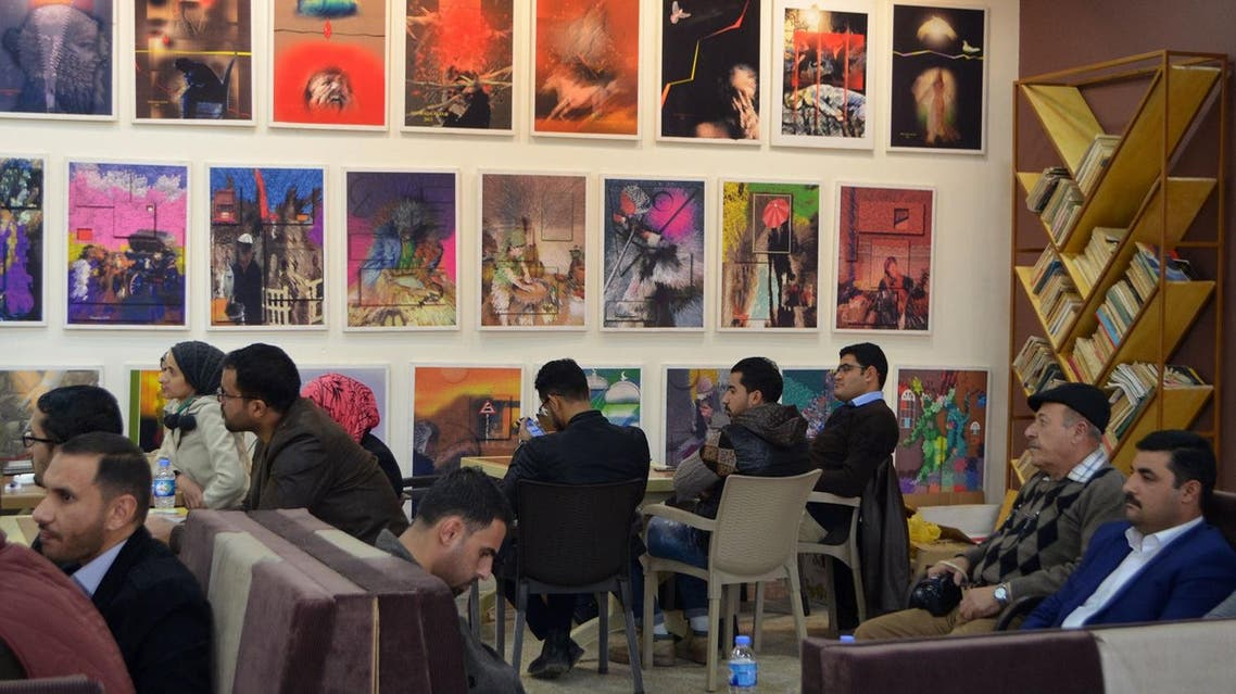 """Iraqis gather at a cultural café named """"Book Forum"""" in the former embattled city of Mosul on January 6, 2018 six months after Iraqi forces retook the northern city from ISIS militants. (AFP)"""
