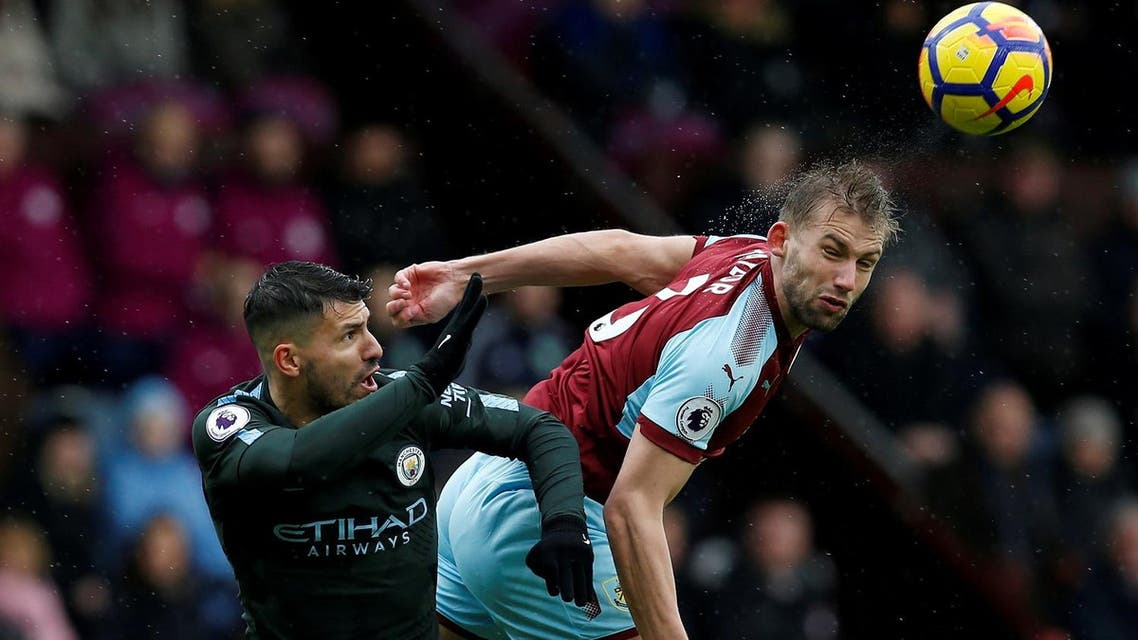 Burnley's Charlie Taylor in action with Manchester City's Sergio Aguero. (Reuters)