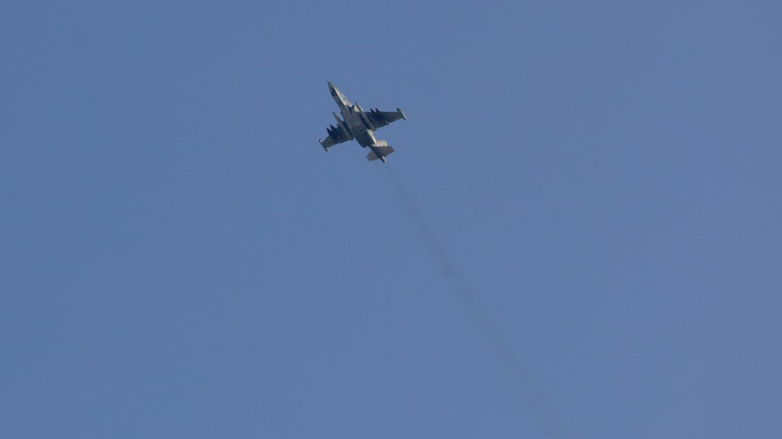 A picture taken on February 1, 2018, shows a Sukhoi-25 fighter jet flying over the Syrian city of Saraqib, southwest of Aleppo. Rebel fighters shot down a Russian plane over Syria's northwest Idlib province on February 3, the Syrian Observatory for Human Rights said, taking its Russian pilot captive.  OMAR HAJ KADOUR / AFP
