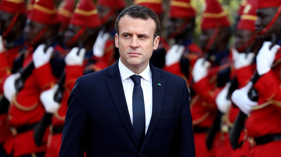 French President Emmanuel Macron reviews troops during a ceremony at the presidential palace before a meeting with Senegalese President in Dakar. (Reuters)