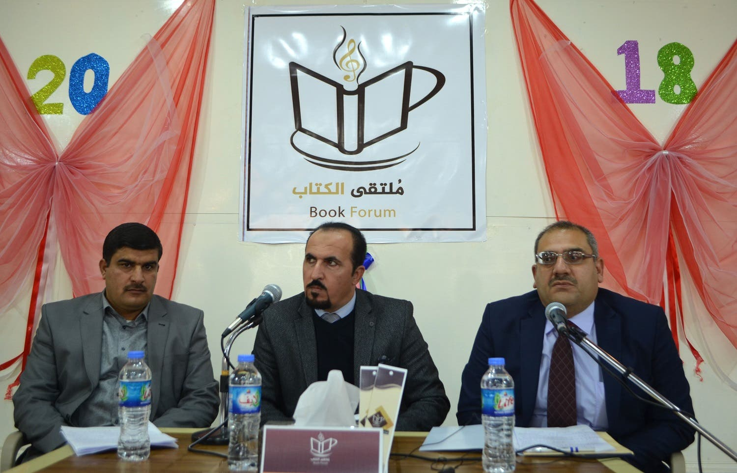 """Iraqis gather at a cultural café named """"Book Forum"""" in the former embattled city of Mosul on January 6, 2018. (AFP)"""