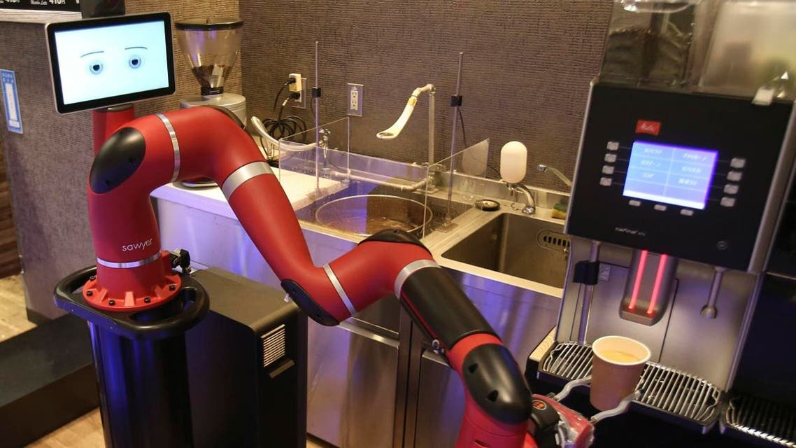 "Robot barista named ""Sawyer"" makes a coffee at Henn-na Cafe, meaning ""Strange Cafe"" in Japanese, in Tokyo. (AP)"