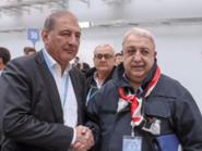 """""""جزّار بانياس"""" ورئيس منصة موسكو في سجال بسبب صورة"""