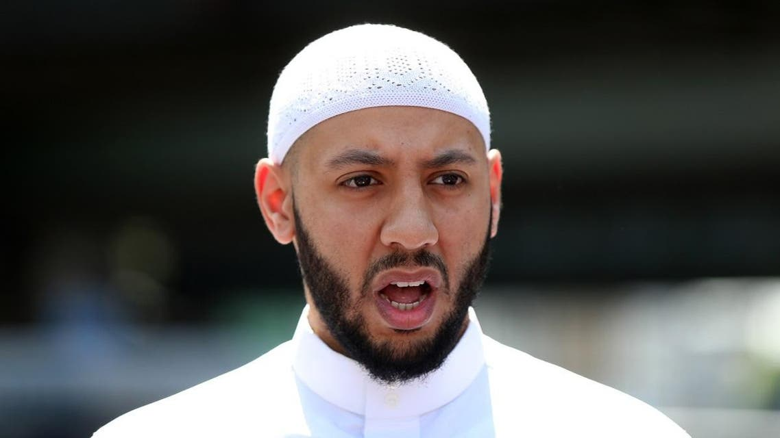 Mohammed Mahmoud, an Imam at Finsbury Park Mosque, gives a statement to the media at a police cordon in the Finsbury Park area of north London. (AFP)