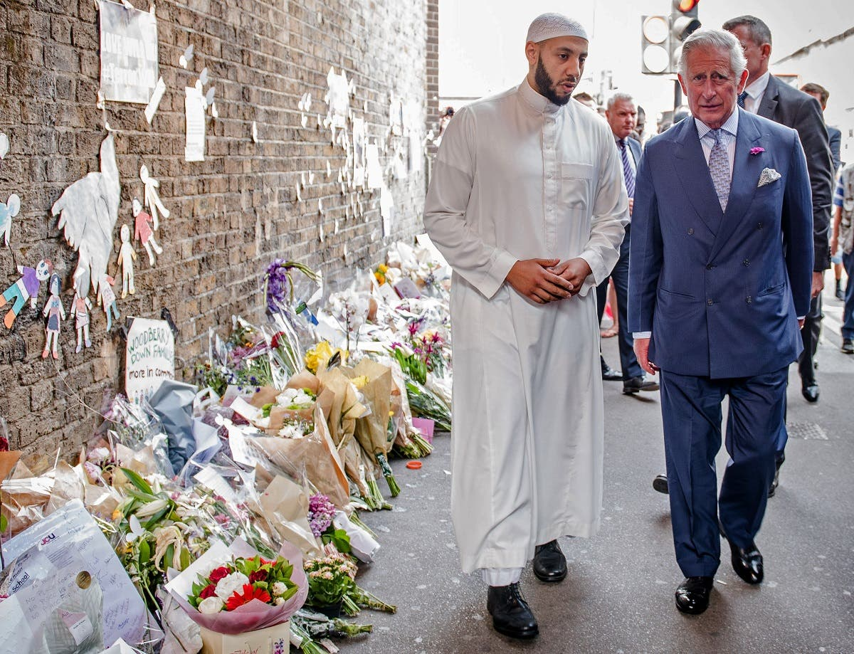 Britain's Prince Charles, Prince of Wales (R) and Imam Mohammed Mahmoud (L) visit floral tributes left close to the scene of the Finsbury Mosque attack in the Finsbury Park area of north London on June 21, 2017. (AFP)
