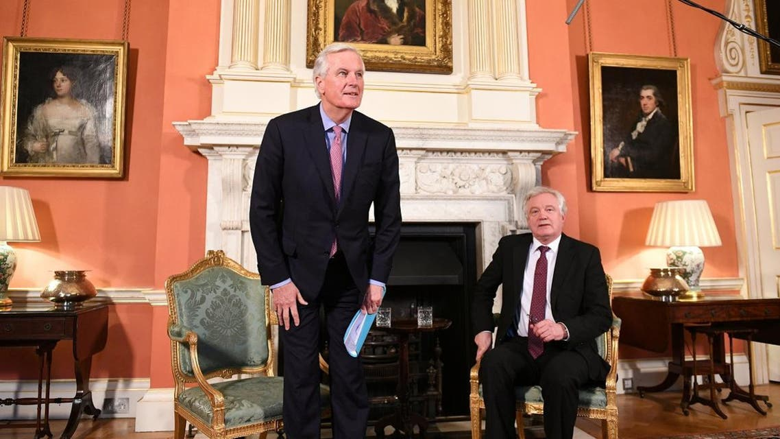 Britain's Secretary of State for Exiting the European Union David Davis and the European Union's chief Brexit negotiator Michel Barnier arrive before speaking inside 10 Downing Street. (Reuters)