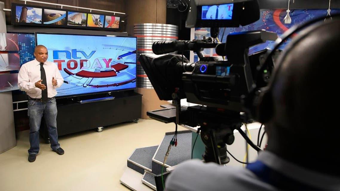 NTV news reporter Sean Cardovillis speaks in a studio of Kenyan 'Nation Media Group' (NMG) in Nairobi. (AFP)