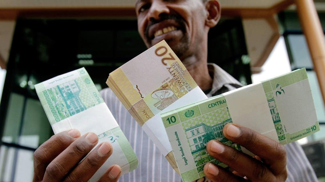 A Sudanese man shows freshly-minted notes of the new Sudanese pound in Khartoum. (AFP)
