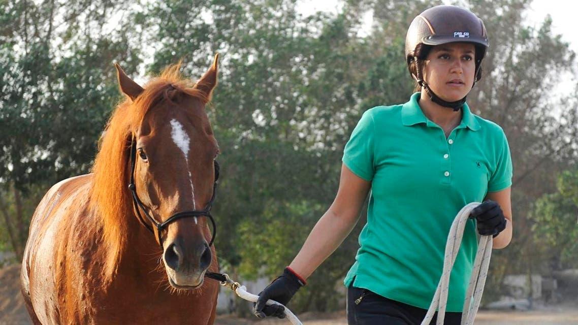 Saudi Dana al-Gosaibi walks a horse during a training session. (AFP)