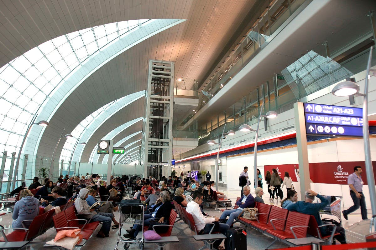 passengers wait to board an Emirates Airbus A380 aircraft at Concourse A of Dubai airport in Dubai. (AP)