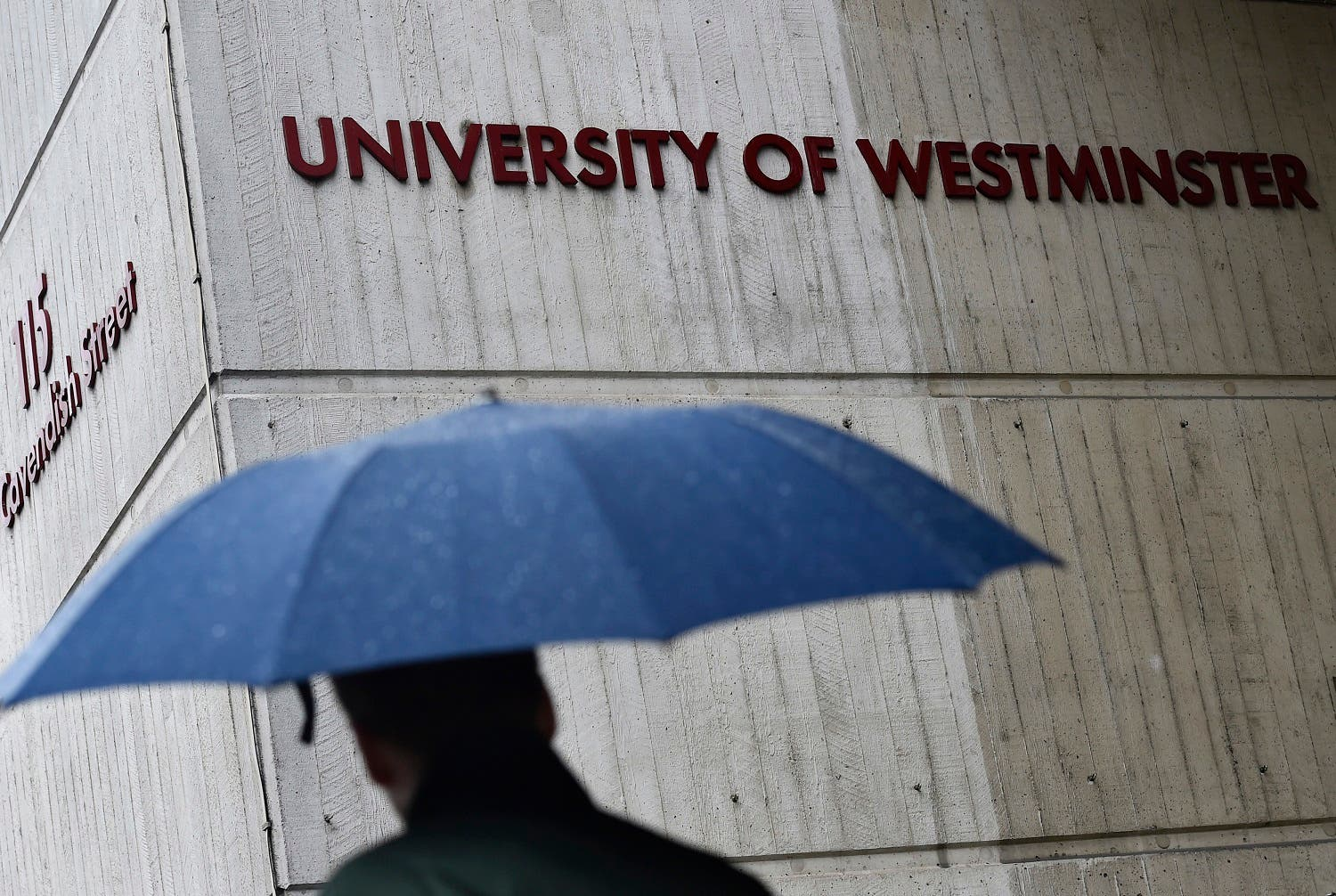 A man walks past a University of Westminster campus building in central London, February 26, 2015. (Reuters)