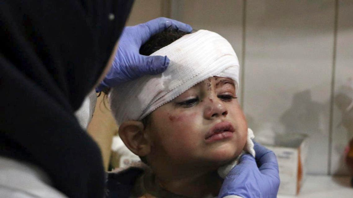 This photo provided by the Syrian anti-government activist group, Ghouta Media Center, GMC, which has been authenticated based on its contents and other AP reporting, shows an injured boy receiving treatment at a hospital in Hazeh in eastern Ghouta, the only remaining rebel stronghold near the capital, Damascus, Syria, Monday, Feb. 5, 2018. (AP)