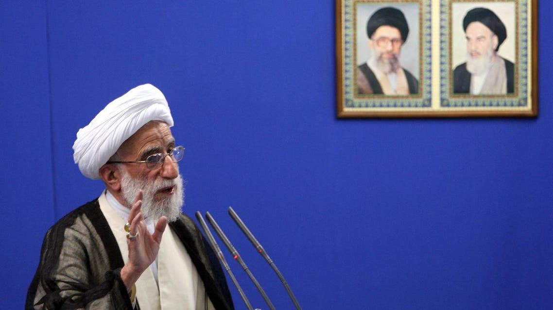 Hard-line head of the powerful Guardian Council of Iran, Ahmad Jannati, delivers his cermon, under pictures of the late revolutionary founder Ayatollah Khomeini, right, and supreme leader Ayatollah Ali Khamenei. (File photo: AP)
