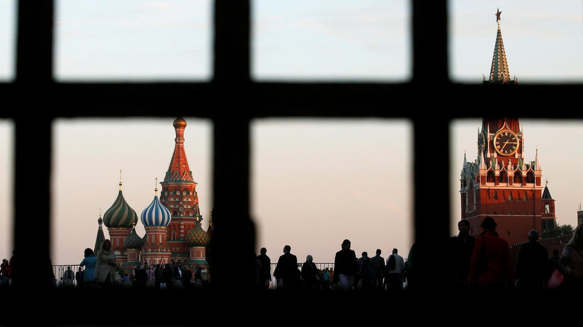 FILE PHOTO: Red Square, St. Basil's Cathedral (L) and the Spasskaya Tower of the Kremlin are seen through a gate in central Moscow, September 18, 2014. Picture taken September 18, 2014. REUTERS/Maxim Zmeyev/File Photo