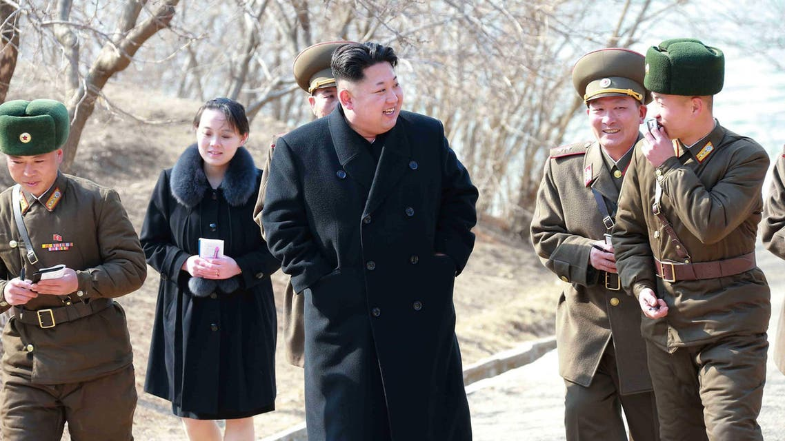 """This undated picture released from North Korea's official Korean Central News Agency (KCNA) on March 12, 2015 shows North Korean leader Kim Jong-Un (C) inspecting the Sin Islet defence company in Kangwon province, while Kim Yo-Jong (2nd L), vice department director of the Central Committee of the Worker's Party of Korea (WPK) and the younger sister of Kim Jong-Un, follows him. AFP PHOTO / KCNA via KNS REPUBLIC OF KOREA OUT THIS PICTURE WAS MADE AVAILABLE BY A THIRD PARTY. AFP CAN NOT INDEPENDENTLY VERIFY THE AUTHENTICITY, LOCATION, DATE AND CONTENT OF THIS IMAGE. THIS PHOTO IS DISTRIBUTED EXACTLY AS RECEIVED BY AFP. ---EDITORS NOTE--- RESTRICTED TO EDITORIAL USE - MANDATORY CREDIT """"AFP PHOTO / KCNA VIA KNS"""" - NO MARKETING NO ADVERTISING CAMPAIGNS - DISTRIBUTED AS A SERVICE TO CLIENTS  KNS / KCNA / AFP"""