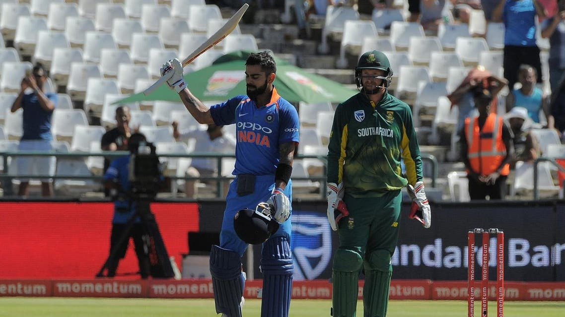 India's Virat Kohli (left) celebrates his century during the One Day International (ODI) cricket match between India and South Africa, at Newland Stadium, on February 7, 2018, in Cape Town. (AFP)