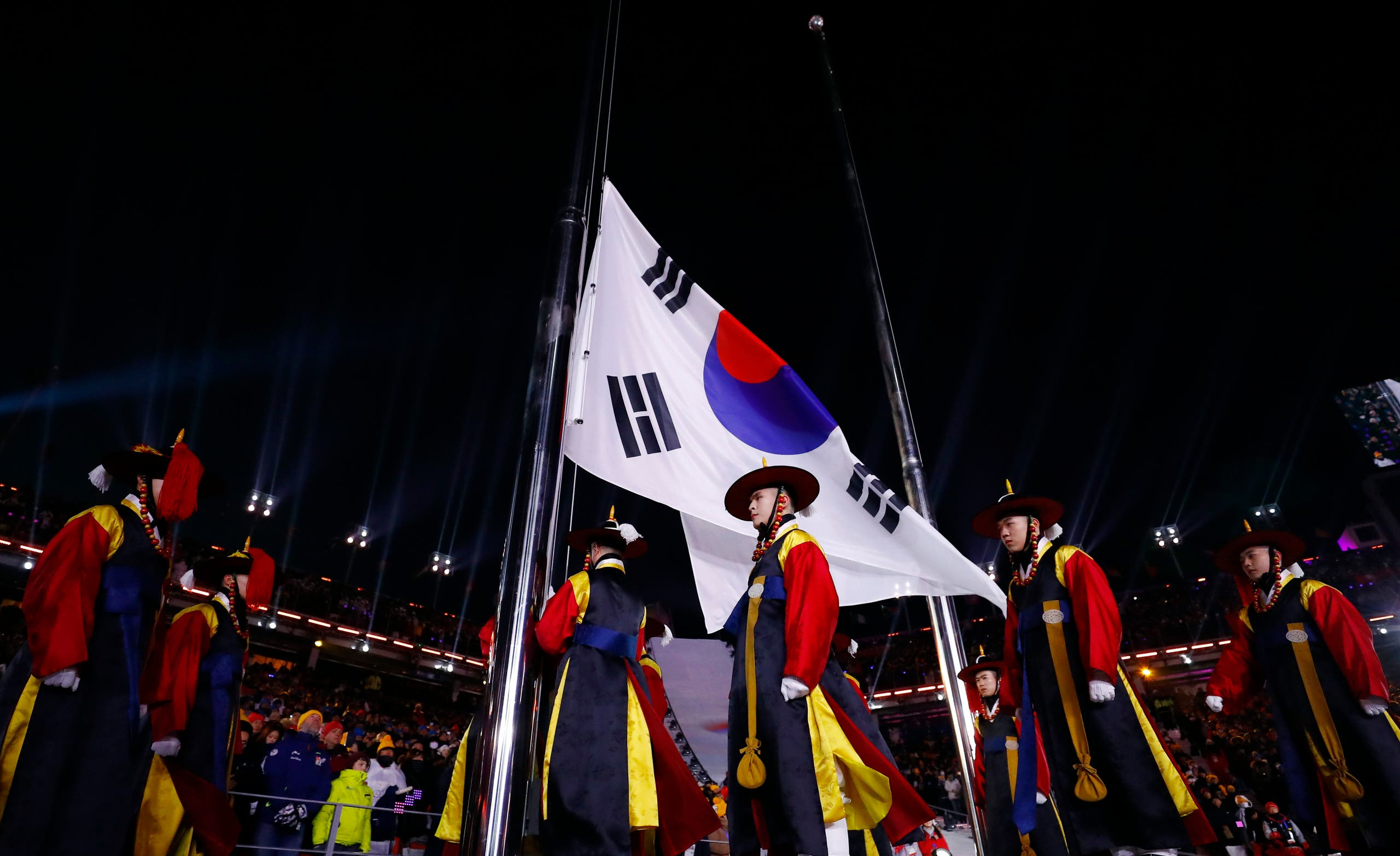 Pyeongchang 2018 Winter Olympics – Opening Ceremony – Pyeongchang Olympic Stadium- Pyeongchang, South Korea – February 9, 2018 - The flag of South Korea is raised during the opening ceremony. REUTERS/Toby Melville