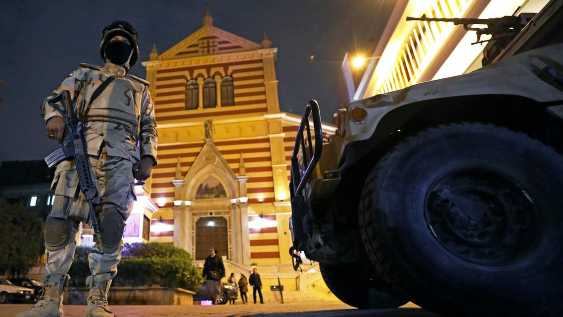 Egyptian army soldiers stand guard during a New Year's Eve mass at Saint Joseph's Roman Catholic Church in Cairo on December 31, 2017. (Reuters)