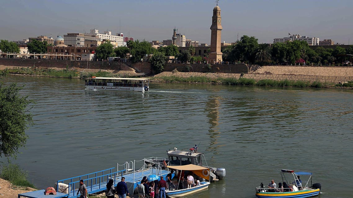 People prepare to board a small boat that transports people over the Tigris river in central Baghdad, Iraq, Friday, Sept. 15, 2017. Many civilians use small boats to cross the Tigris river and avoid the traffic jams and possible attacks on the roads. (AP Photo/Karim Kadim)