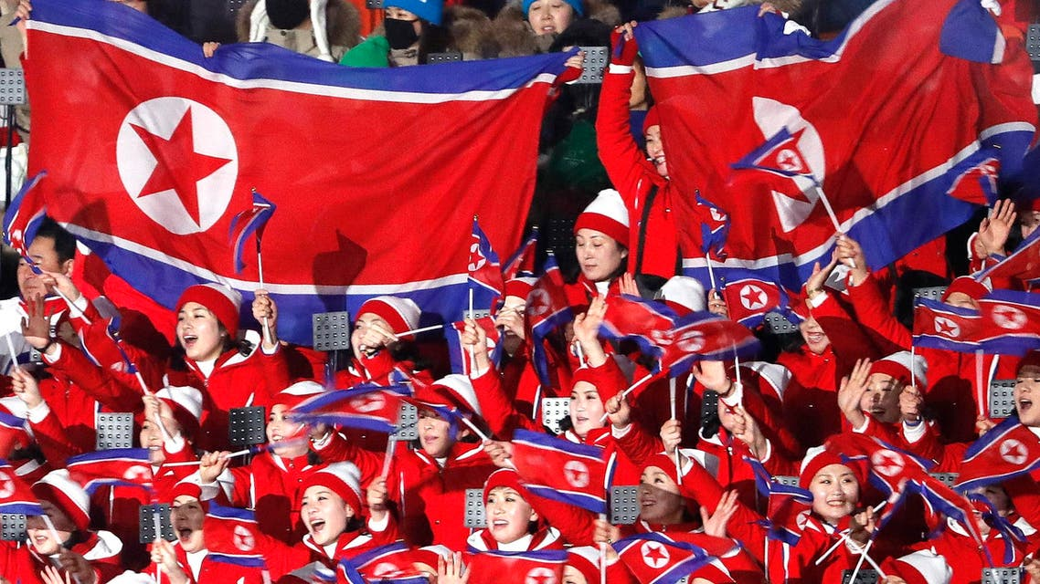 Pyeongchang 2018 Winter Olympics: Cheerleaders of North Korea wave their national flags as they wait the start of the opening ceremony. (Reuters)
