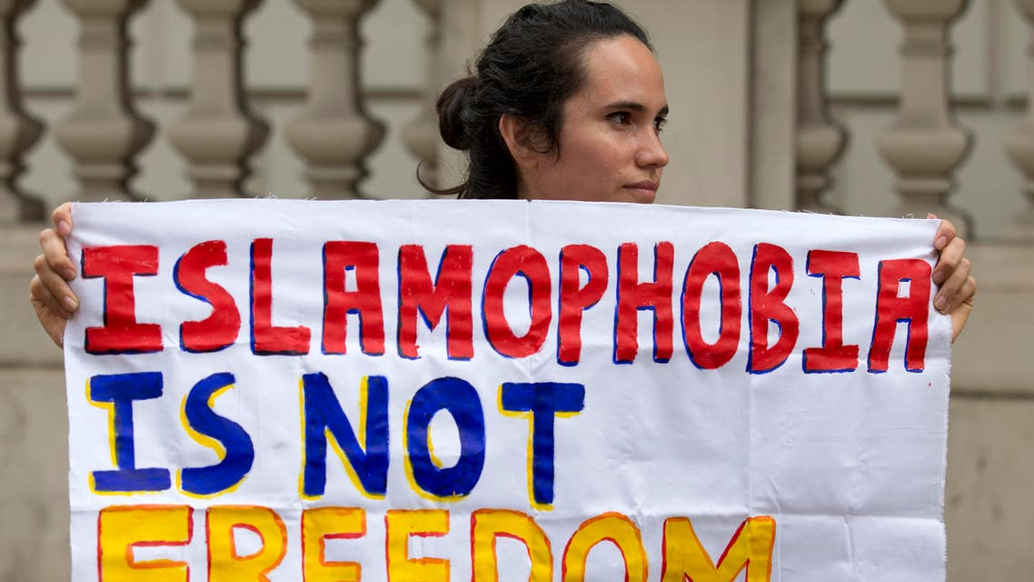 """A protester holds a sign which reads """"Islamophobia is not freedom"""" outside the French Embassy in London on August 25, 2016. (AFP)"""
