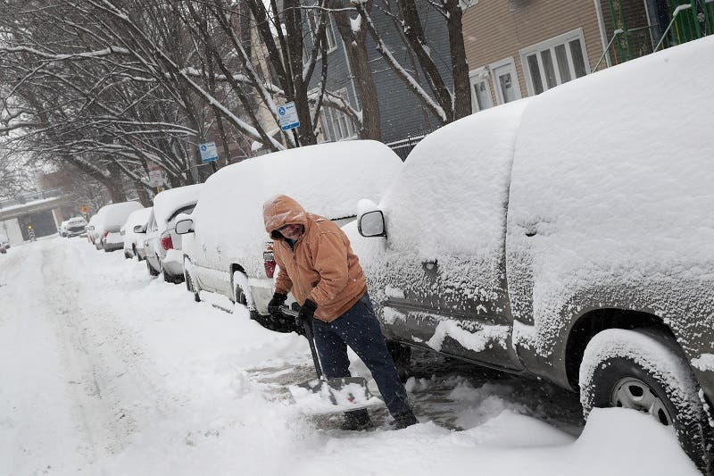 Chicago residents dig out after more than 7 inches of snow fell on the city on February 9, 2018 in Chicago, Illinois. (AFP)