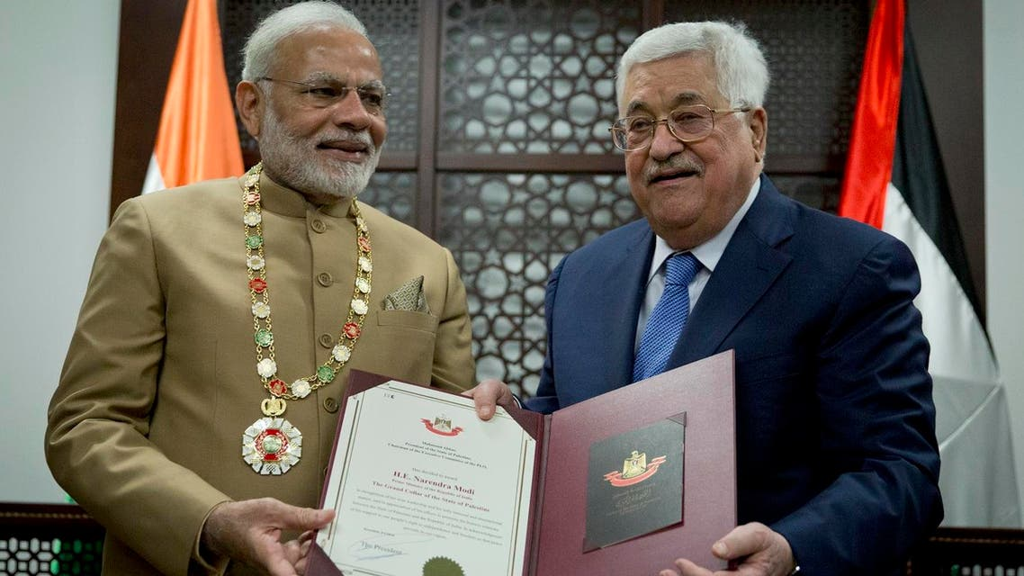 Palestinian President Mahmoud Abbas, (right) decorates Indian Prime Minister Narendra Modi with the Grand Collar of the State of Palestine medal, during his visit to the Palestinian Authority headquarters in the West Bank city of Ramallah, on Saturday, Feb. 10, 2018. (AP)