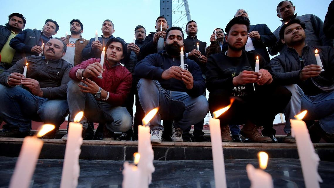 People light candles during a vigil held for the army officers who were killed in an attack earlier this morning at an army camp, in Jammu, February 10, 2018. (Reuters)