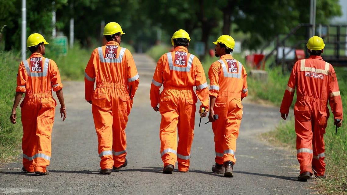 Technicians walk next inside a desalter plant of Oil and Natural Gas Corp (ONGC) on the outskirts of Ahmedabad, India. (AFP)