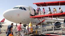 Man runs onto a UAE airport runway to catch plane to meet his fiancée