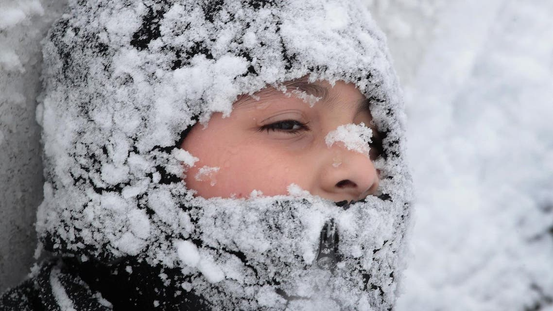 The city is bracing for upwards to 6 more inches before the weather system passes through the area on Sunday. (AFP)