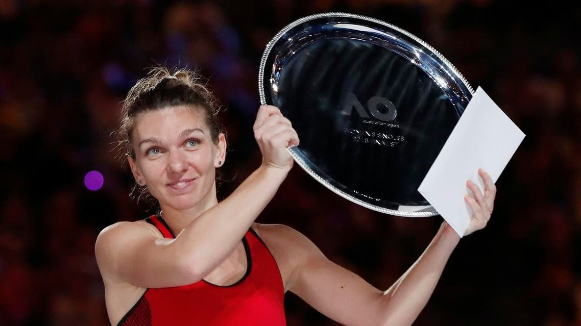 Romania's Simona Halep with the runners up trophy after losing to Denmark's Caroline Wozniacki in the final. (Reuters)