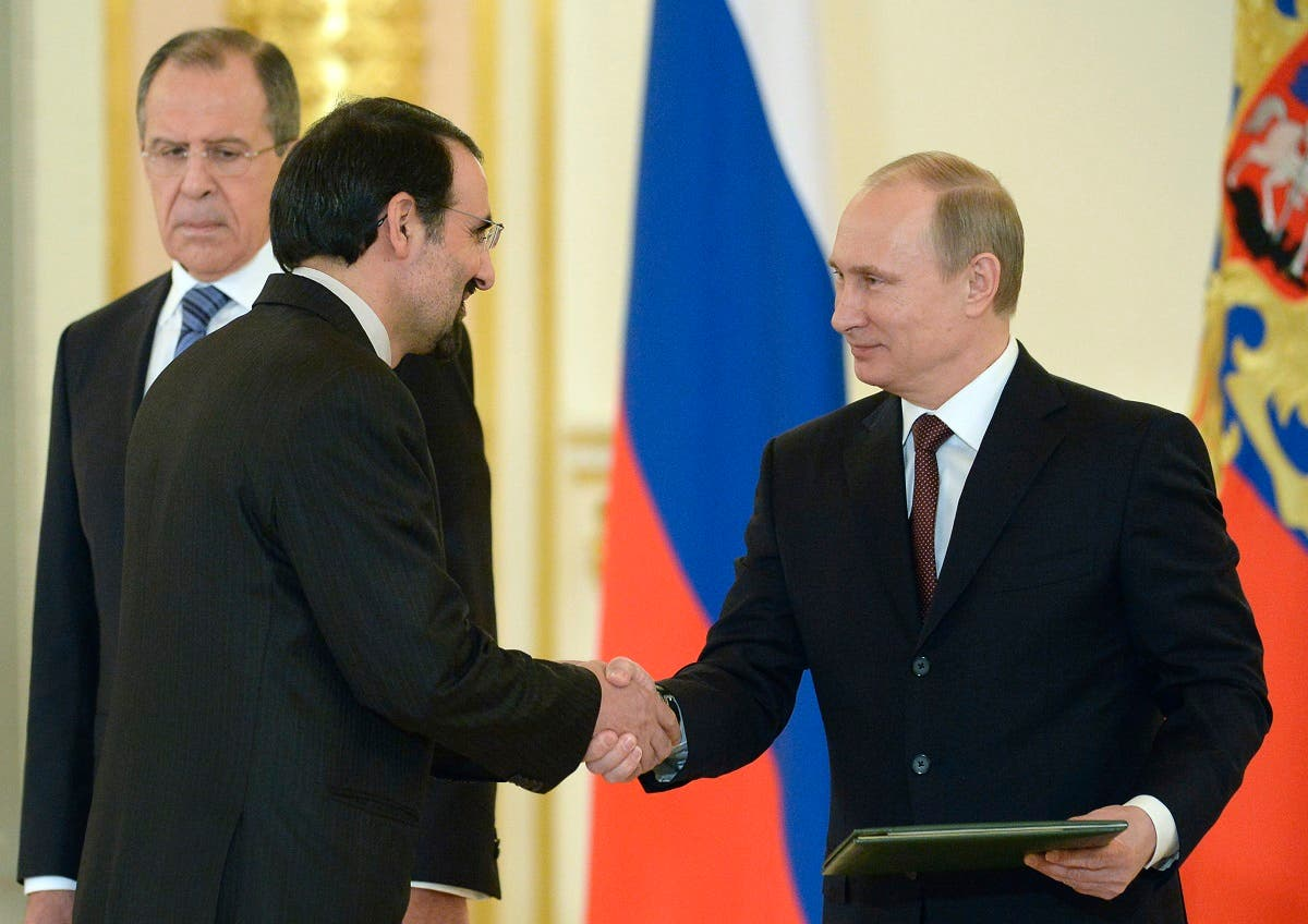 Russia's President Vladimir Putin (R) shakes hands with Iran's ambassador to Russia, Mehdi Sanai, during a ceremony of receiving foreign ambassadors' credentials. (File photo: AFP)