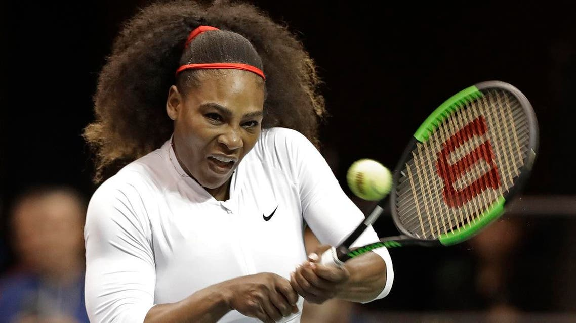 USA's Serena Williams returns a shot against the Netherlands during a doubles match in the first round of Fed Cup tennis competition. (AP)