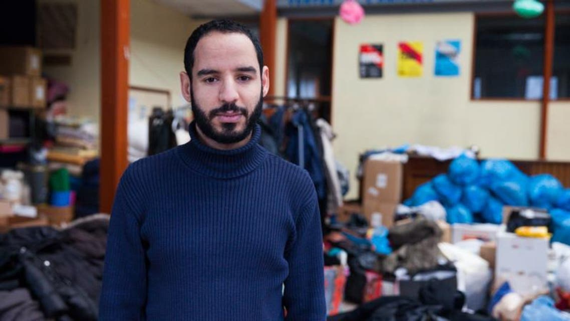 Nabil in the hangar where he collects all the clothes and the food for migrants. (Ghassen Fridhi/Al Arabiya)