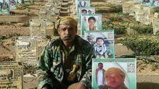 Houthi militant appears next to his grave days after his burial