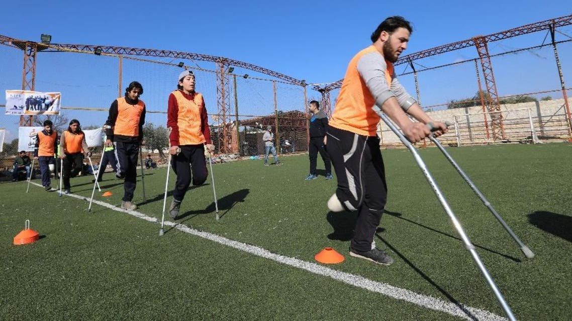 Syrian amputees who were injured in the war warm up for a football match organised by a centre for physical therapy in Idlib, the last province in the country outside government control, on January 15, 2018