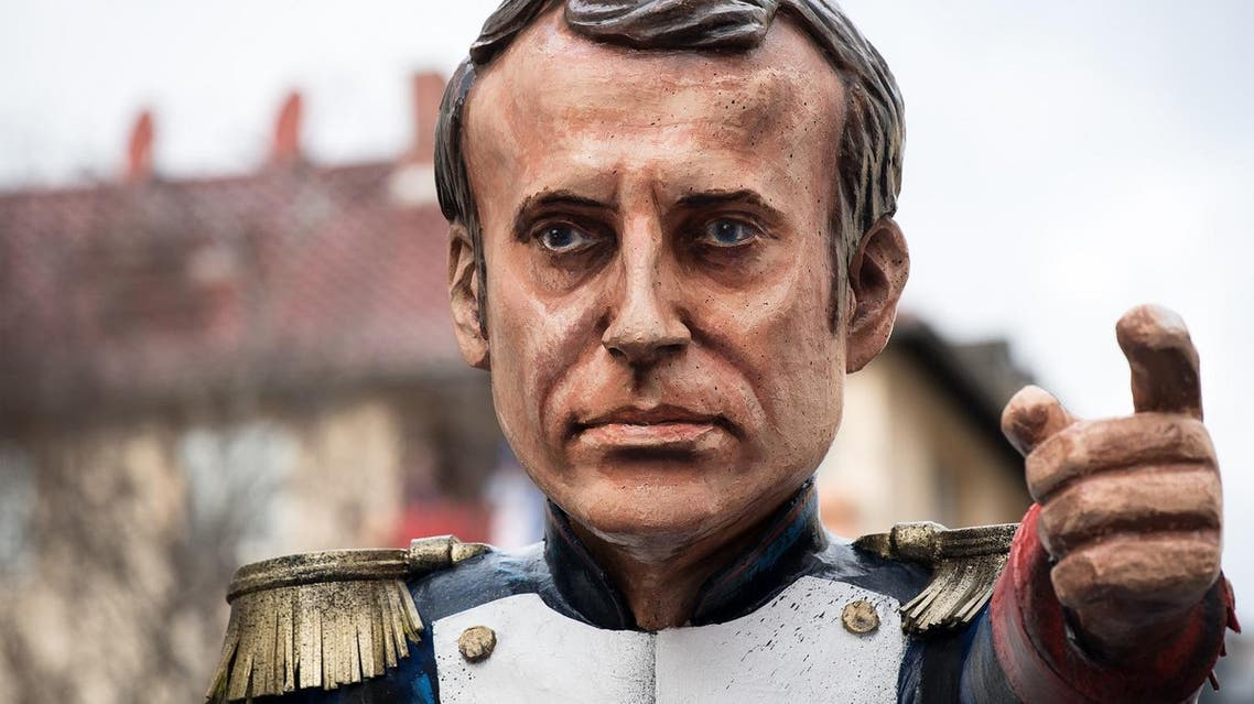 A carnival float, depicting a caricature of French President Emmanuel Macron in Napoleon pose, is pictured during a carnival parade on Rose Monday on February 12, 2018 in Mainz, western Germany.  (AFP)
