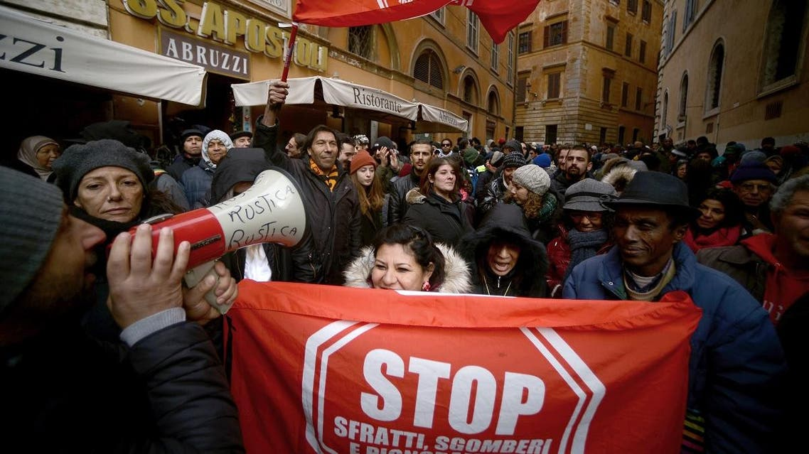 Members of the movement for the Struggle for Housing, migrants and evicted people demonstrate against the unseen Italian far right Lega Nord party leader Matteo Salvini. (AFP)