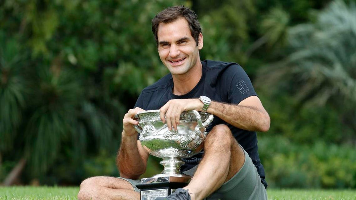 Roger Federer of Switzerland poses with the men's singles trophy during the winner's photoshoot. (Reuters)