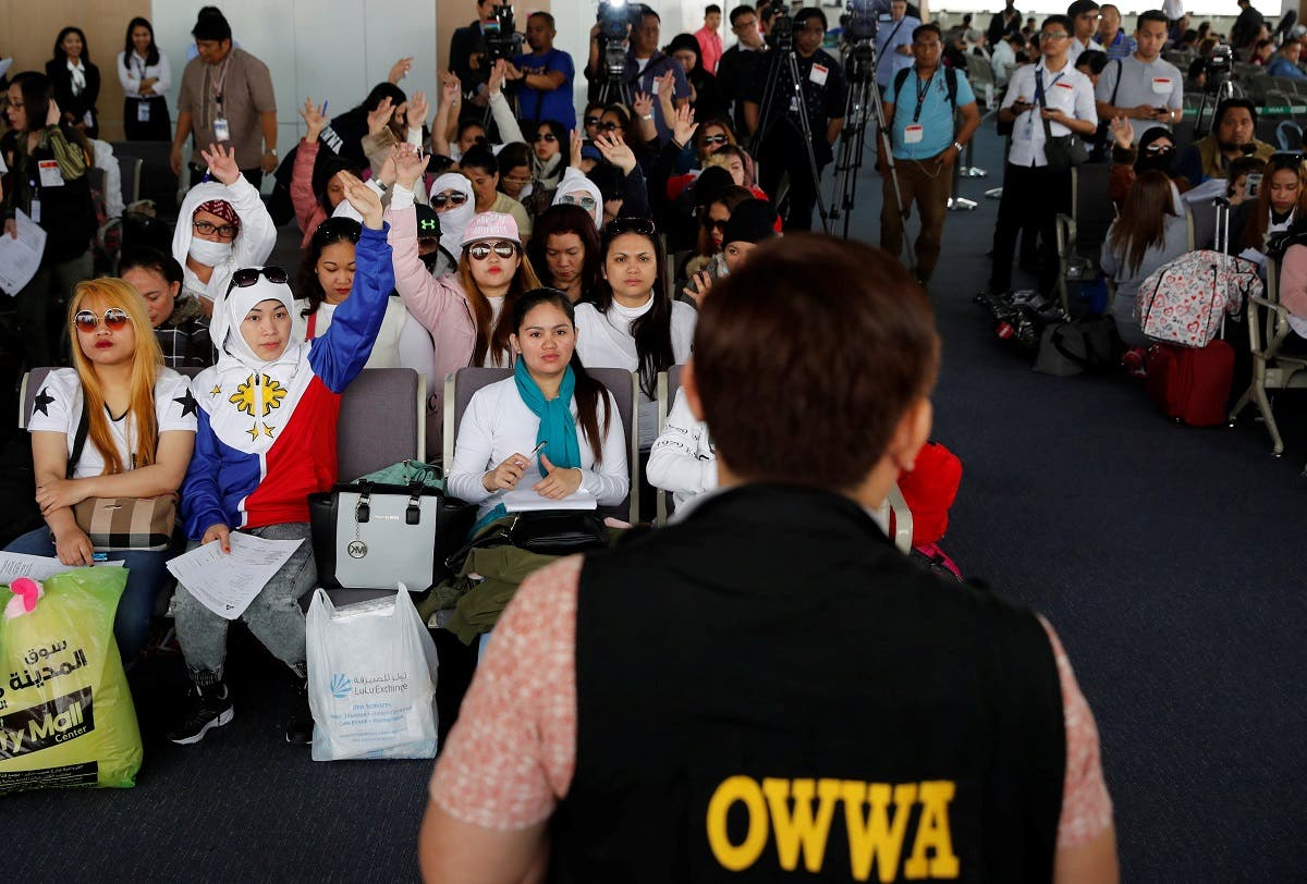 Filipino workers who were repatriated from Kuwait take part in a dialogue with a Department of Labour official in Paranaque. (Reuters)