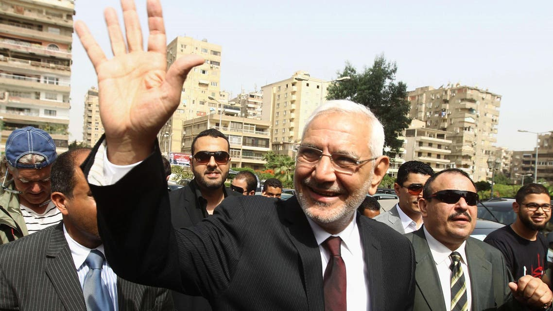 Abdel Moneim Abul Fotouh arrives to vote in Cairo during the country's presidential election on May 23, 2012. (AFP)