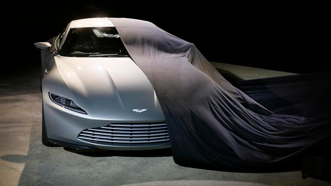 """An Aston Martin DB10 car is unveiled on stage during an event to mark the start of production for the new James Bond film """"Spectre"""", at Pinewood Studios in Iver Heath, southern England December 4, 2014. (Reuters)"""