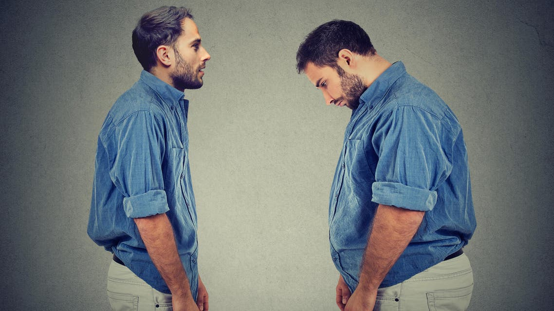 Slim guy looking at fat man himself. Diet choice right nutrition concept - Stock image...
