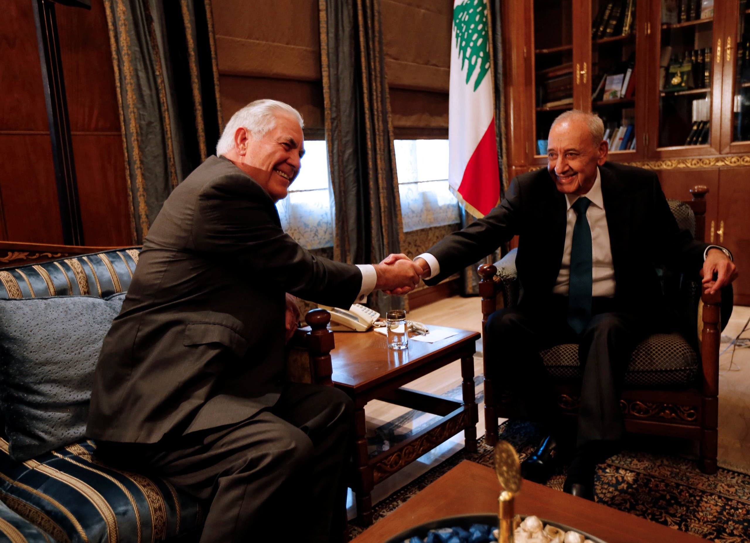 Lebanese Parliament Speaker Nabih Berri shakes hands with U.S. Secretary of State Rex Tillerson in Beirut, Lebanon February 15, 2018. REUTERS/Jamal Saidi